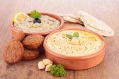 Hummus, aubergine caviar and pita bread — Stock Photo