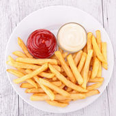 Plate of french fries — Stock Photo