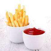 French fries and ketchup — Stock Photo