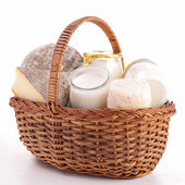 Wicker basket with dairy product — Stock Photo