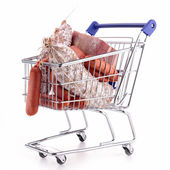 Shopping cart with meat — Stock Photo