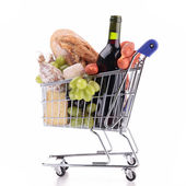 Shopping cart with groceries — Stock Photo