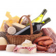 Wicker basket with sausage, wine and cheese — Stock Photo #24455979