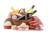 Wicker basket with sausage, wine and cheese — Stock Photo