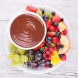 Stock Photo: Chocolate sauce and fruits