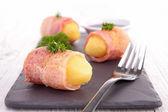 Potato wrapped in bacon — Stock Photo