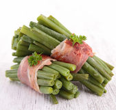 Green bean wrapped in bacon — Stock Photo