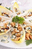 Chicory salad with walnut and roquefort — Stock Photo