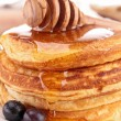 Pancake with honey — Stock Photo