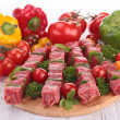 Raw beef kebab and ingredient — Stock Photo