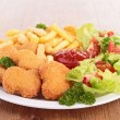 Chicken nuggets,french fries and salad — Stock Photo