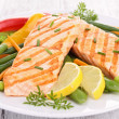 Grilled salmon and vegetables — Stock Photo