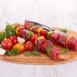 Board with raw beef and vegetable kebab — Stock Photo