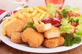 Nugget,french fries and salad — Stock Photo