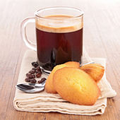 Coffee and madeleine — Stock Photo