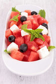 Fruit salad with watermelon and feta — Stock Photo