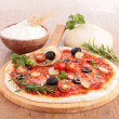 Pizza dough with tomato sauce and ingredients — Stock Photo