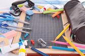 Blackboard and school supplies — Stock Photo