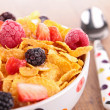 Bowl of cornflakes and berries — Stock Photo