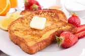 Bread with butter and honey — Stock Photo