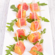 Melon with prosciutto ham — Stock Photo