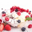 Bowl of ice cream and berries — Stock Photo