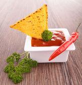 Tortilla chip with salsa dip — Stock Photo