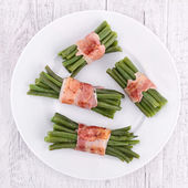 Green bean wrapped in bacon — Stok fotoğraf