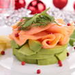 Salmon and avocado with christmas decoration — Stock Photo #30864687