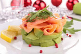 Salmon and avocado with christmas decoration — Stock Photo