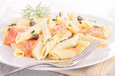 Pasta with salmon and cream — Stock Photo