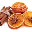 Isolated dried orange slices and cinnamon — Stock Photo