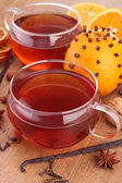 Cup of red tea and orange — Stock Photo