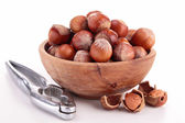 Bowl with hazelnuts and nutcracker — Stock Photo