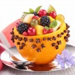 Fruit salad in orange bowl — Stock Photo #32119999