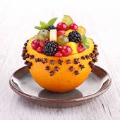 Fruit salad in orange bowl — Stock Photo