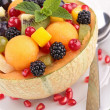 Fruit salad in melon bowl — Stockfoto