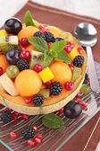 Fruit salad in melon bowl — Stock Photo
