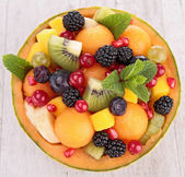 Fruit salad in melon bowl — Stock Photo
