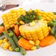 Plate of corn and vegetables — Stock Photo