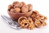 Walnuts and nutcracker — Stock Photo