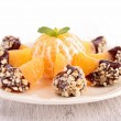 Clementine with chocolate sauce — Stock Photo