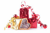 Gift with heart shape biscuit — Stock Photo
