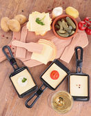 Raclette and ingredients — Photo