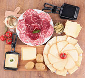 Raclette and ingredients — Stockfoto