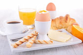 Egg, coffee and croissant — Stock Photo
