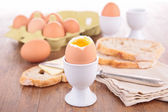 Boiled egg and bread — Stock Photo