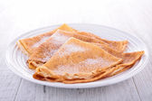 Crepes with sugar — Stock Photo