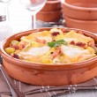 Stock Photo: Baked potato with cheese and bacon, tartiflette