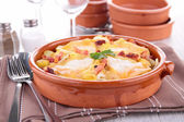 Baked potato with cheese and bacon, tartiflette — Stock Photo